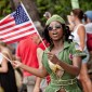 Westin Resort troop member Carries US flag at St. John Carnival